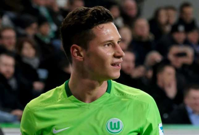 Julian Draxler German star signs for PSG from Wolfsburg   The 23-year-old attacking midfielder has signed a contract for a reported 36 to 40 million euros.  German international Julian Draxler has joined Paris Saint-Germain from Wolfsburg on a four-year deal the French club said Tuesday.  The 23-year-old attacking midfielder has signed a contract for a reported 36 to 40 million euros ($37.5 million - $42 million) that will keep him at the top French club until the end of June 2021. Draxler…
