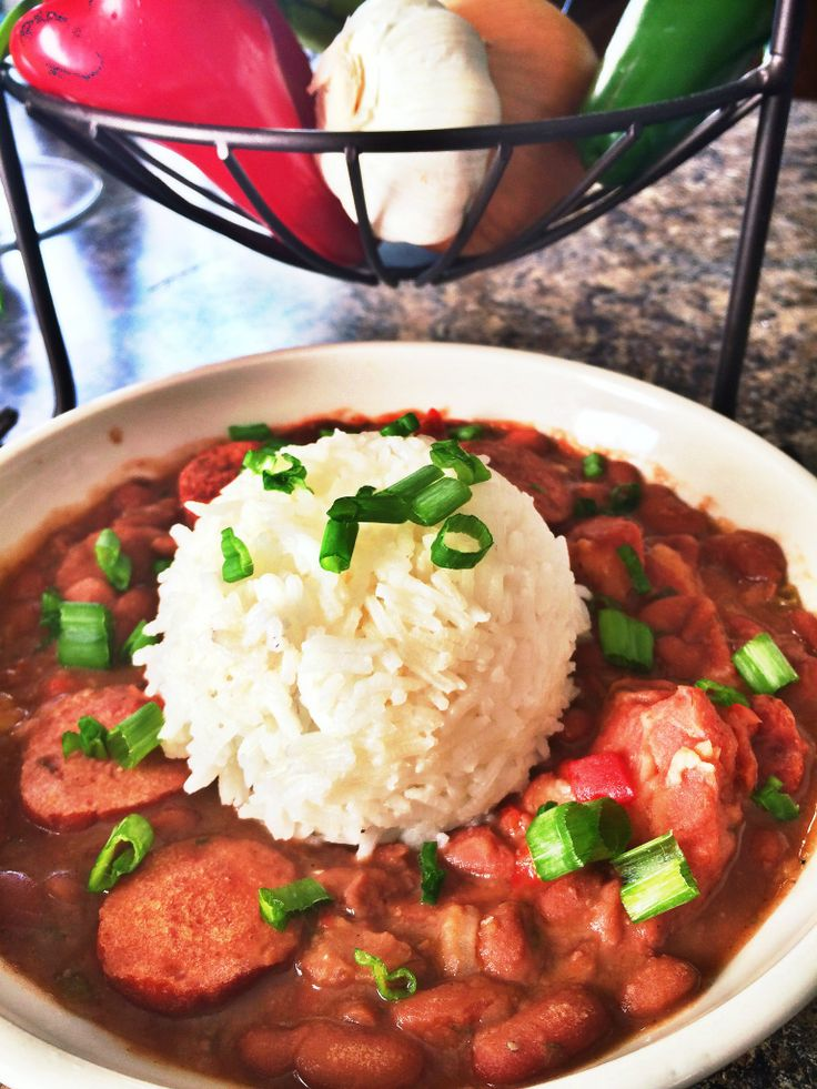 The BEST Red Beans and Rice with Sausage Recipe... It feels like home with every bite you take. This would be great with cornbread muffins.