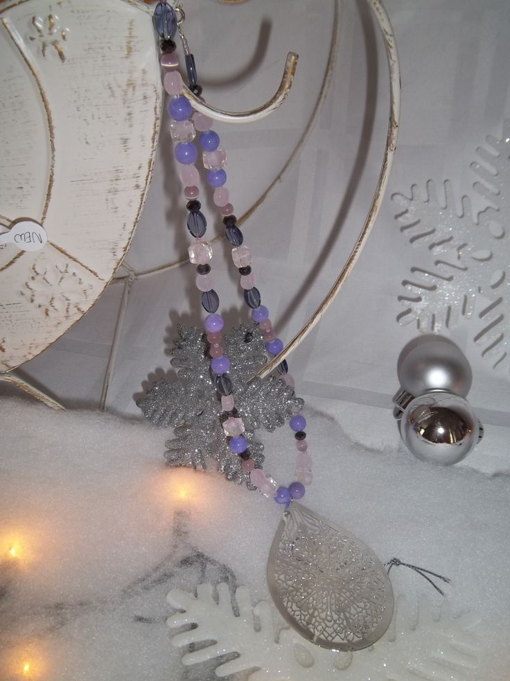 New cut out pendant with pretty purple beaded necklace