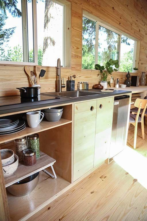 Tiny Home on the Coast | Tiny Heirloom Luxury Custom Built Tiny Homes (full size fridge and eliminate the holes on the cabinet doors, use another way to open them, no built in burners, double bowl sink) #LuxuryFridges #luxurycandles
