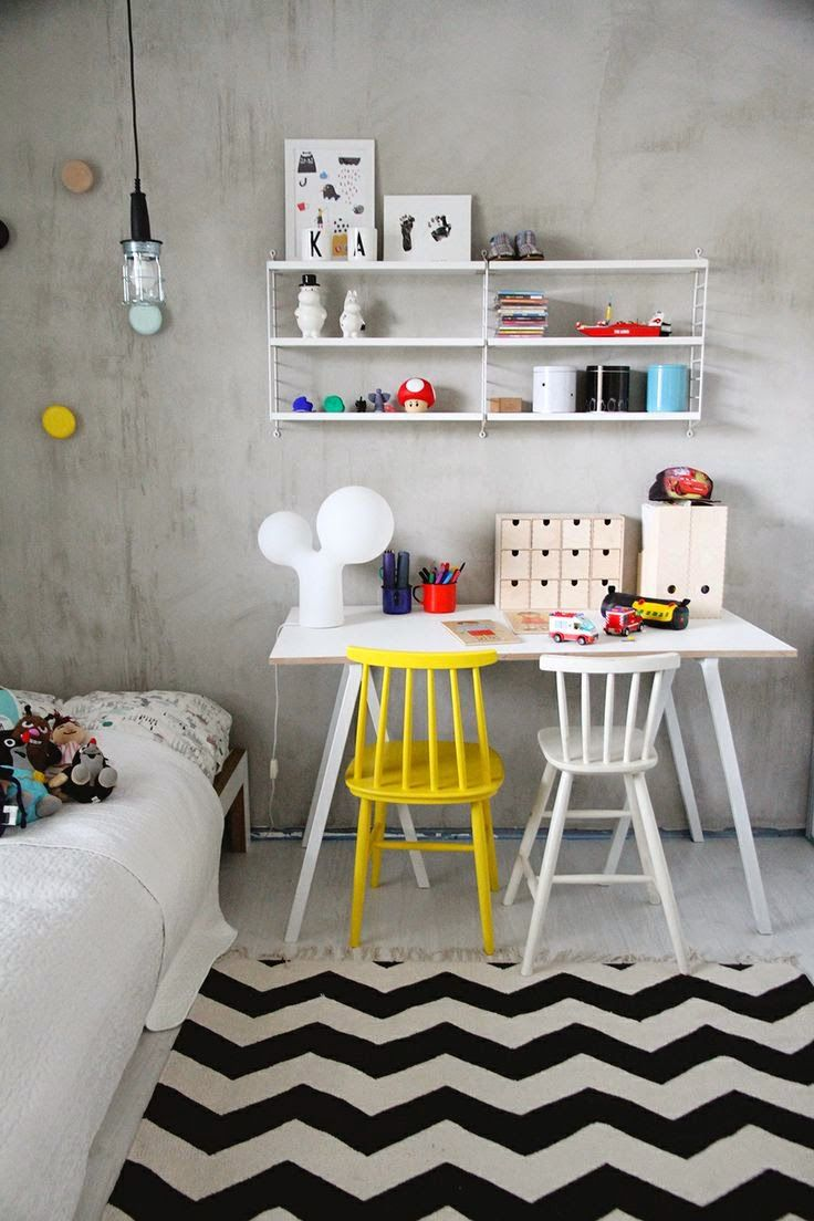 Great idea, an un painted concrete wall with pops of bright yellow