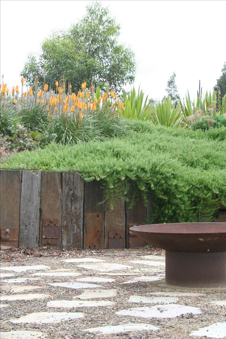 Rustic fire pit,sanstone with compacted gravel,retaining wall. www.rpgardendesign.com.au