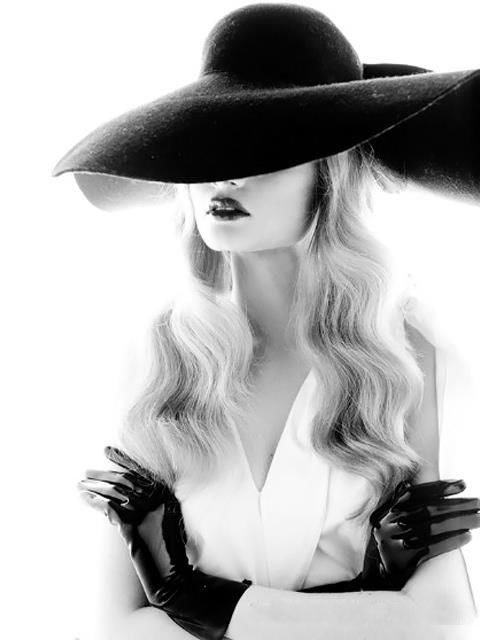 Model posing in a fedora hat. Fashion Photography