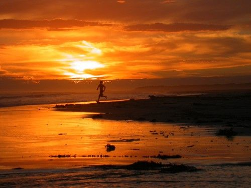 Man running - Piccaninnie Ponds Beach. Photograph by Liz Powley.