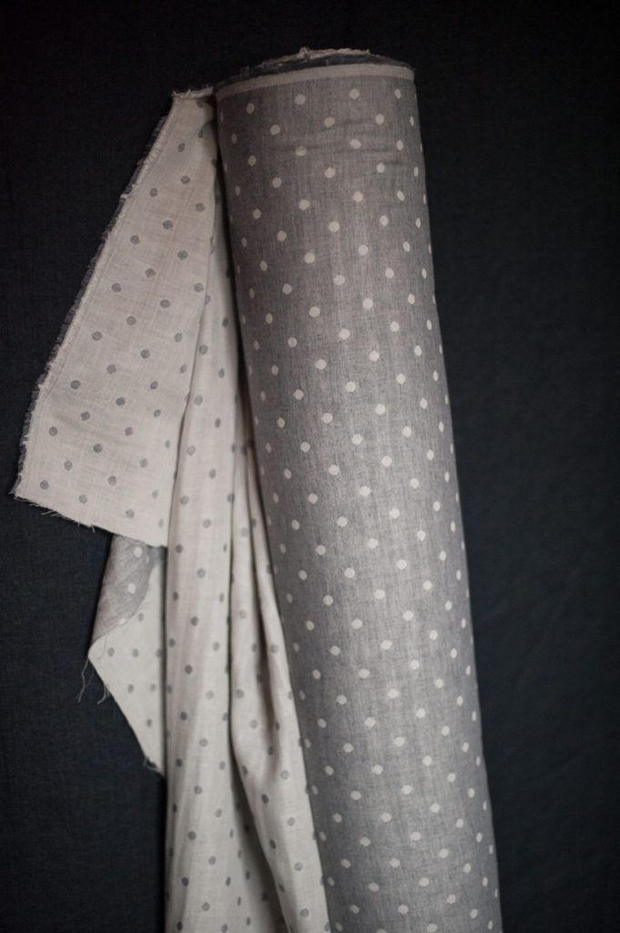 A Japanese double gauze organic cotton. Soft grey muslin one side and slate greycotton spots on the reverse. 112cm wide. 116g/m. Wash at 40 degrees, do not tumble dry. Twin Spot Grey is suitable for the following patterns in our Workbook: Bantam and Heron.