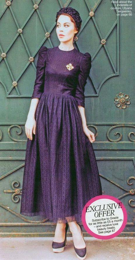 Ulyana Sergeenko in a purple outfit