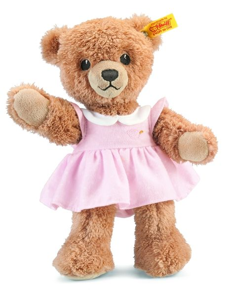 """Lull your little ones to dreamland with Steiff's Sleep Well Bear. Made of the cuddliest soft plush to match your baby's soft skin. And when your little one wakes up, this adorable Teddy bear with pink dress will greet your baby with her sparkling embroidered eyes and smile. For your baby's safety, Steiff uses  Part of the Steiff Sleep Well Bear Collection. Purchase with matching gift box for a great gift for the new mom and dad. Machine Washable.  With the world famous """"Button in Ear,""""…"""