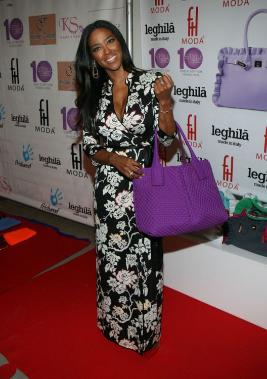 Kenya Moore wears floor length floral dress in black and white carries purple purse