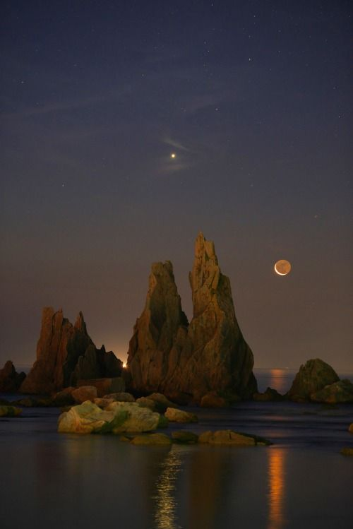 "Off the coast of Japan: ""Venus,The Crescent Moon and Rocks"". Photography by Masahisa Uemura on Flickr"