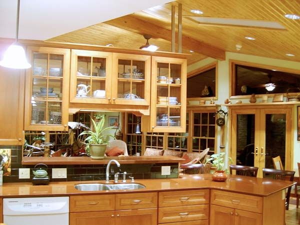 Light and Airy Suspended Cabinets: After from this old house's Best Kitchen Before and Afters 2013