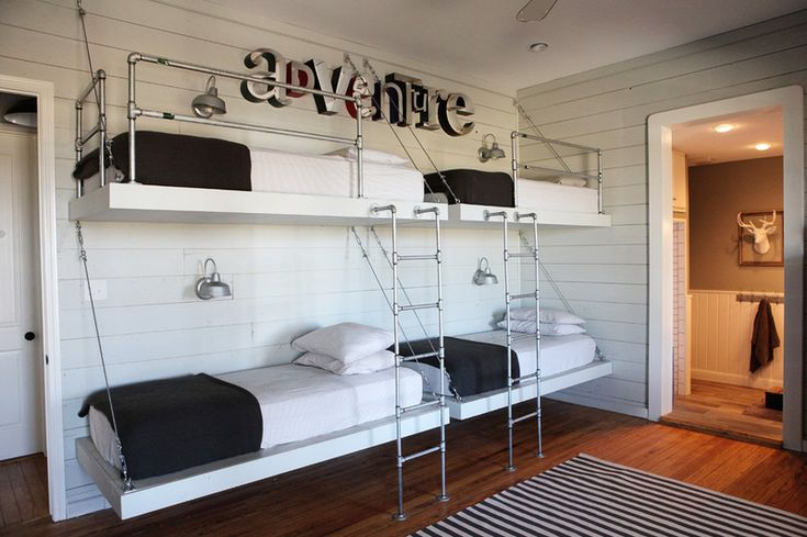 All four children enjoy spending time together, so they share a single bunk room on the main floor. Joanna had the beds built from plumbing ...