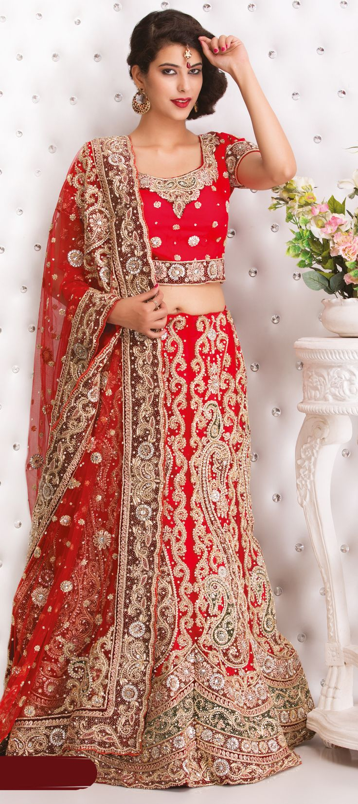 164126: Red and Maroon color family Bridal Lehenga .