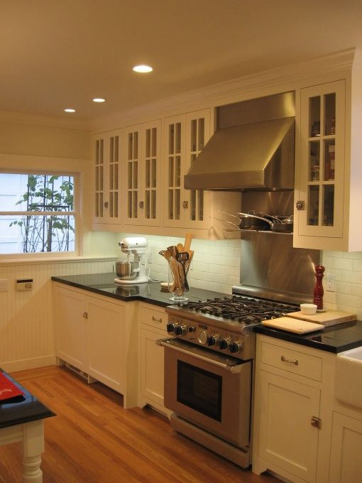 white cabinets, stainless steel appliances, white subway ...