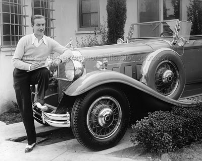Walt Disney and his brand new 1932 Packard DeLuxe Roadster.