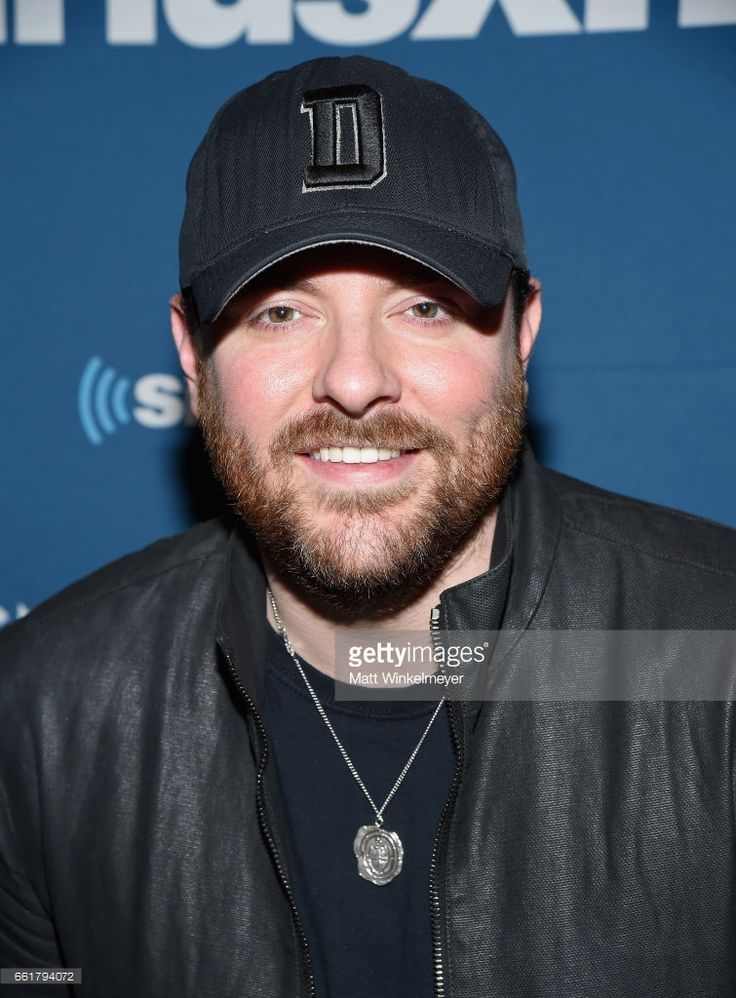 Singer-songwriter Chris Young poses with SiriusXM's The Highway Channel as they broadcast backstage leading up to the American Country Music Awards at the T-Mobile Arena on March 31, 2017 in Las Vegas, Nevada.