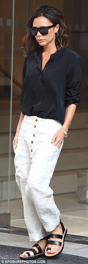 On Tuesday she sported a near-identical style shirt, this time in black...                                                                                                                                                                                 More