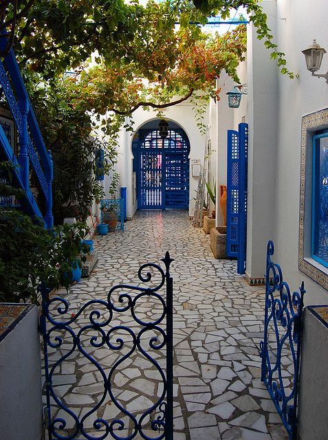 Lovely courtyard in Sidi Bou Said, Tunisia..    This place is truly like heaven on earth. The walkways, the architecture, the colors, the weather! I felt so at peace looking out over the bay with the mountains in the distance. This place is truly my dream home abroad!