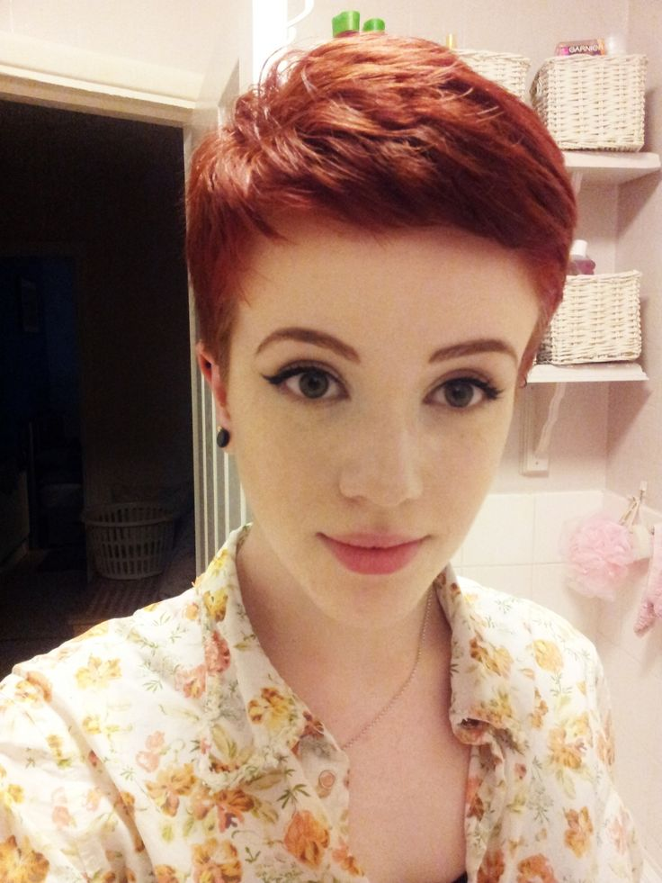 I LOVE this cute pixie cut, she has such a pretty red hair color too. It's rare to find a redhead with a cute pixie cut...or is it?