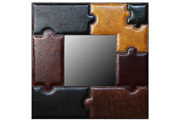 Think I will try to replicate this myself.  Can do this by adhering vinyl fabric in different colors to match my color scheme cut out to look like puzzle pieces to a plain flat mirror.  Same look for a lot less money.