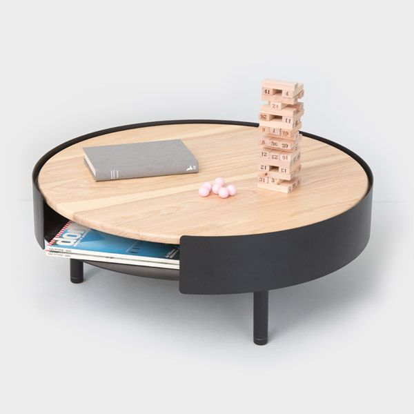 Coco Coffee Table. Put all your coffee on this one. The wooden top lifts off to access the storage space underneath.