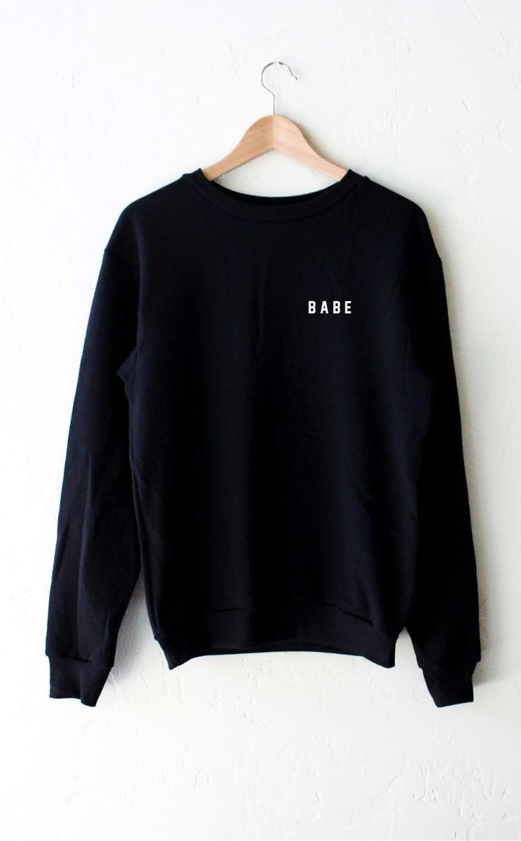 - Description - Size Guide Details: Super soft oversized crew neck fleece sweatshirt in black with print featuring 'Babe' by NYCT Clothing. Oversized, Unisex fit. 50% Cotton, 50% Polyester. Made in US