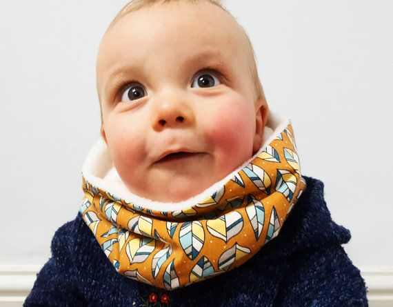 Perfect for the colder days, this super snuggly handmade kids snood/ baby infinity scarf is made from 100% GOTS-certified organic cotton and anti-pilling fleece, which makes it wonderfully soft and warm. The kids scarf fits over your little ones head in one loop and has a loose fit.  Care instructions:  Your item has been pre-washed. All materials are machine washable at 30 degrees. After drying, iron the baby snood to remove creases. Please do not tumble dry.  If you have any more quest...
