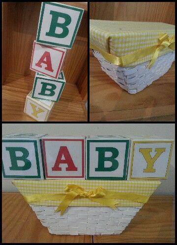 Baby theme risers (letter blocks-printed &laminated onto homemade cardboard cube, basket- cardboard, paint, fabric & ribbon)