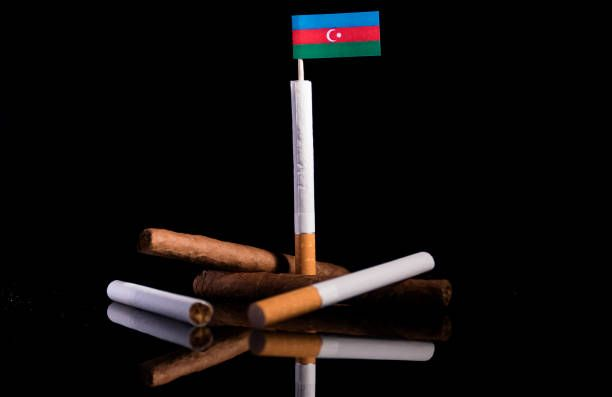 azerbaijan flag with cigarettes and cigars tobacco industry concept