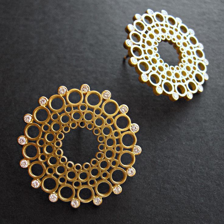 Spiro Earrings. 18ct yellow gold with 0.60ct of diamonds. £3000