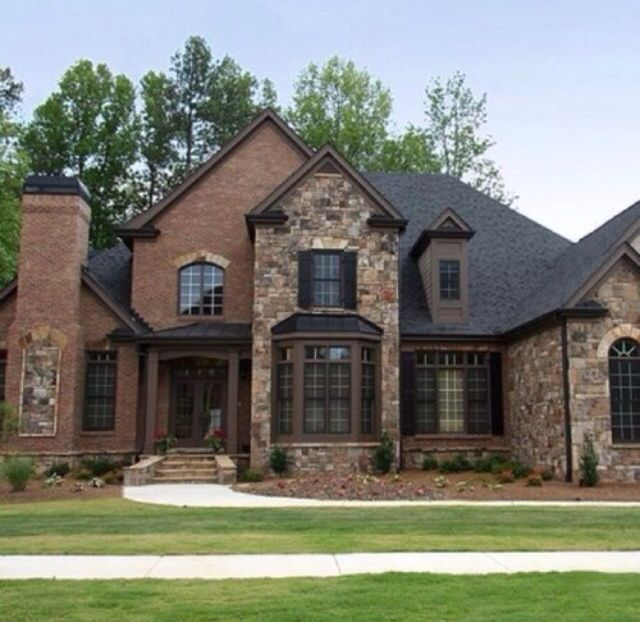 Brick and stone home exteriors pictures of puppies.