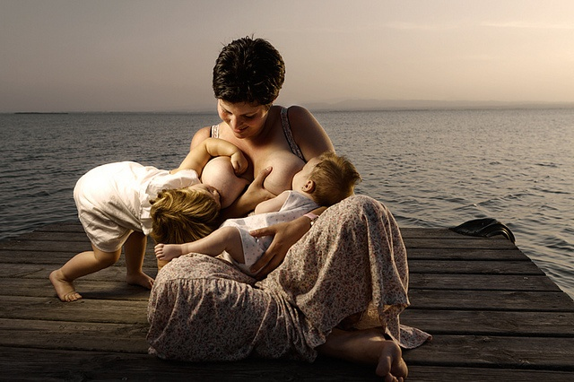 Naked breastfeed in beach