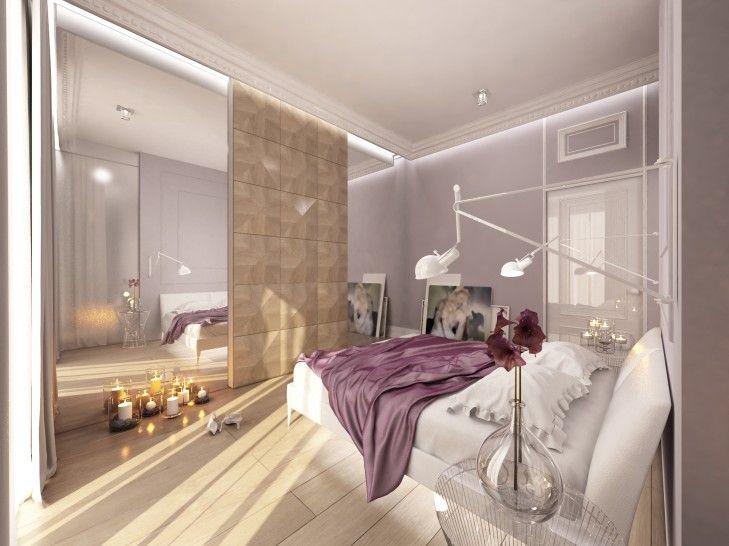 Stylowe wnętrze zaprojektowane z dbałością o detal. Na wprost łóżka znajduje się szafa z drzwiami przesuwnymi wykończonymi dekoracyjnym fornirem dębowym układanym w piramidki.