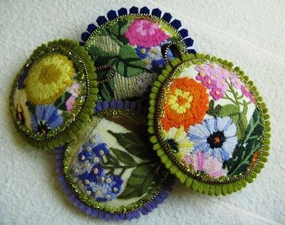 felt pins embellished with brass zippers and crewel embroidery