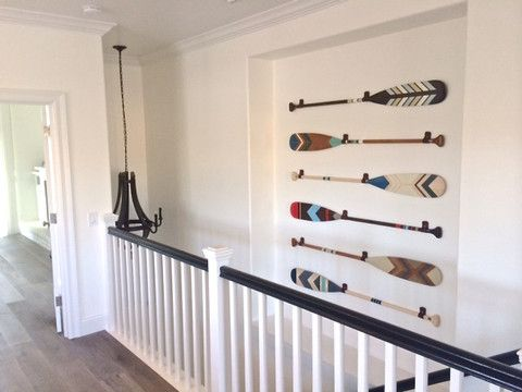 Beach house in California. Hand painted canoe paddles by www.ropesandwood.com #californiabeachhousedecor