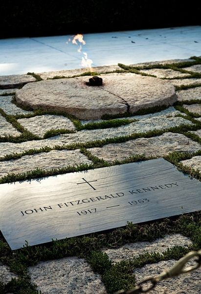 President John Fitzgerald Kennedy was buried in Arlington National Cemetery on November 25, 1963. The site was designed by architect John Carl Warnecke, a long-time friend of President Kennedy's. The permanent John F. Kennedy Eternal Flame grave site was consecrated and opened to the public on March 15, 1967.  http://www.arlingtoncemetery.net/jfk.htm