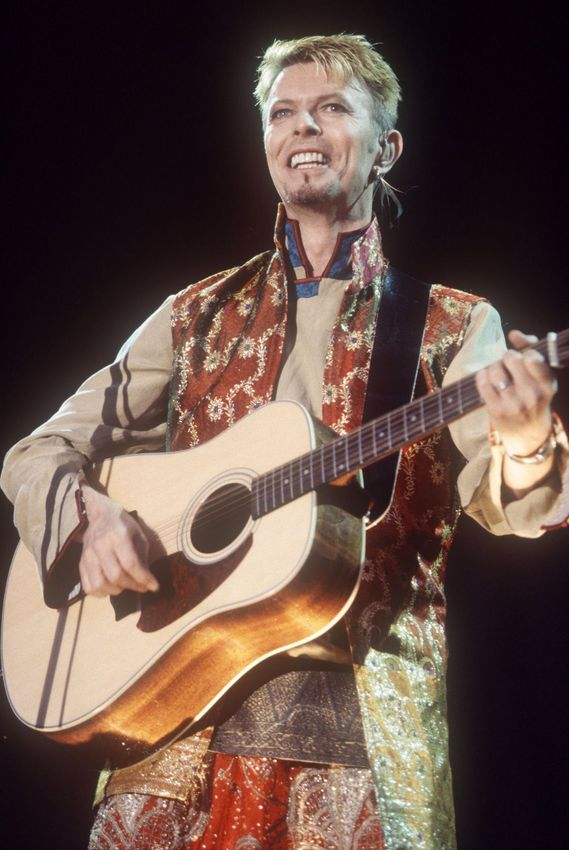 David Bowie performs at the Phoenix Music Festival, Stratford Upon Avon, Britain in 1997.