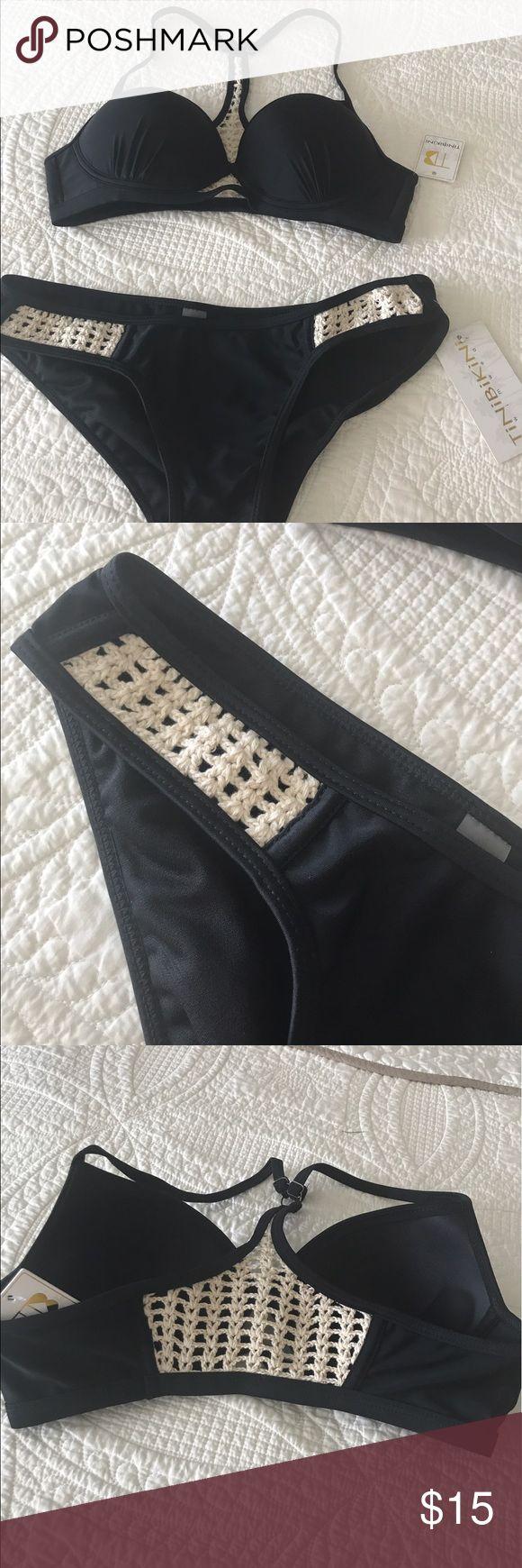 Bikini Tinibikini black and cream bikini.  Super cute,  crochet detail on sides of bottom and back of top.  Well padded.  Never worn,  tags still on.  The top is too small for me 🙁 tinibikini Swim Bikinis