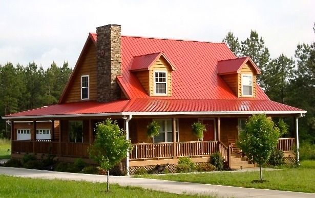 Red metal roof on a cabin style home with wrap around Brick home plans with wrap around porch