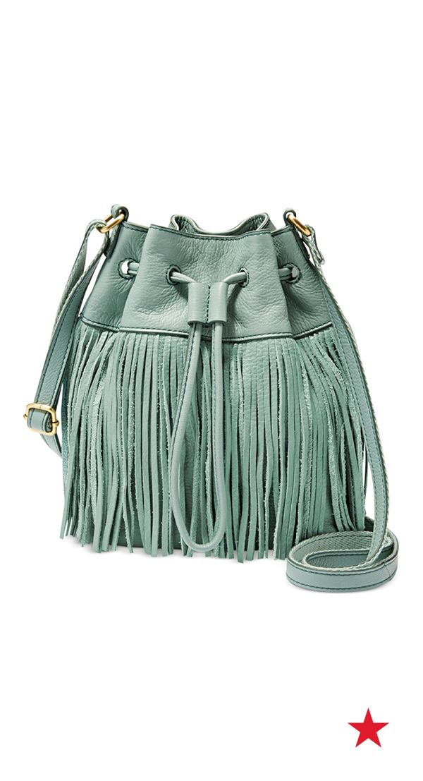 Spring style don't mean a thing if it ain't got that swing. What better way to lay on the drama than with a cute fringe bucket bag? Fossil Jules fringe leather drawstring mini bag