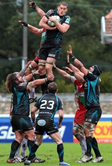 Osprey's Ian Evans jumps for the ball during the team's Heineken European Cup rugby union match against Biarritz in Biarritz, France.
