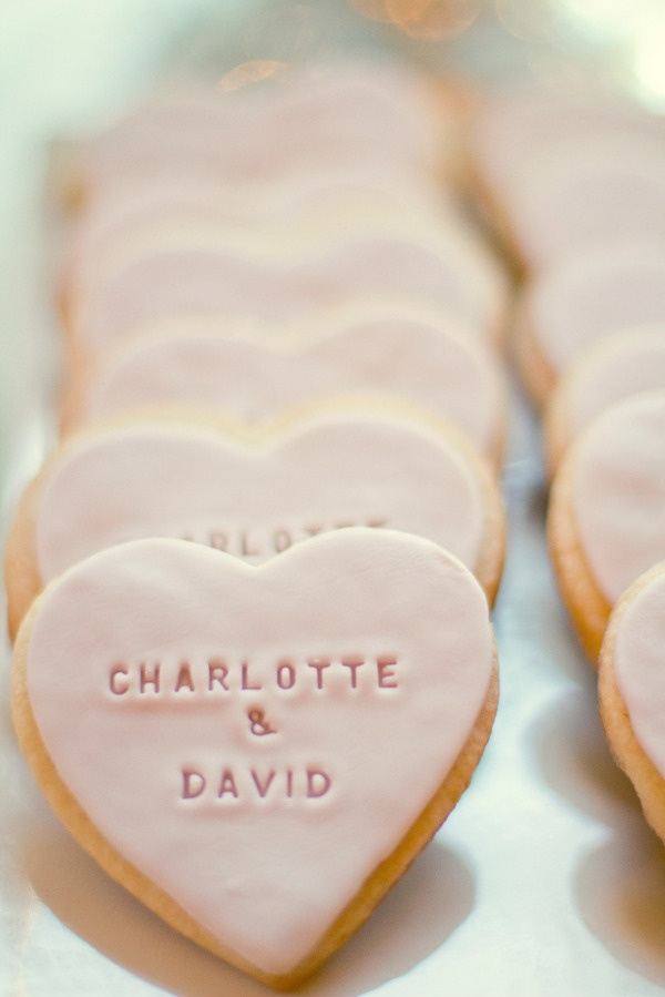 Super cute favors. Easy DIY can be sugar cookies, chocolate or lemon cookies, add fondant and get a stamp to indent your names on the cookie. Wrap up 2 and give them out!
