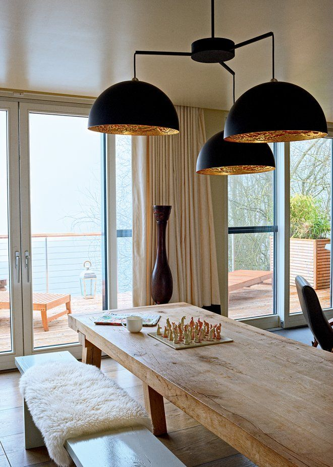 Une salle à manger design qui mêle les matières