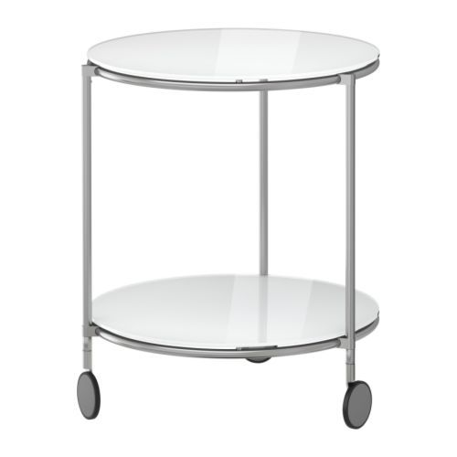 IKEA - STRIND, Side table, , Separate shelf for magazines, etc. helps you keep your things organized and the table top clear.The casters make it easy to move the table if needed.