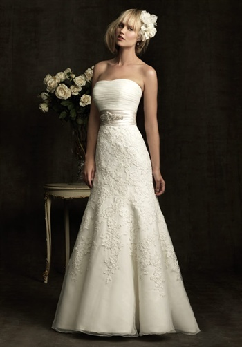 Gown features beading, embroidery, and lace.