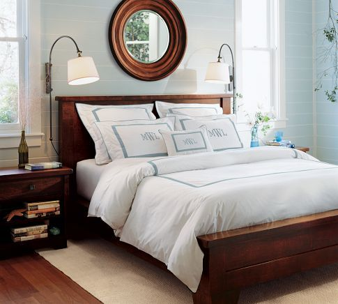 this is my bed (the frame, not the sheets).  someday i will own the entire set.  i may have to win the lottery first though.