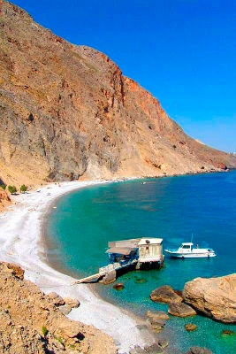 """Glyka Nera  beach (Sweat Water) Glyka Nera (meaning """"sweet water"""") is one of the most beautiful beaches in Crete, with deep blue water color and nice pebbles. In 2003, the beach was ranked among the best 20 in Europe by London Times."""