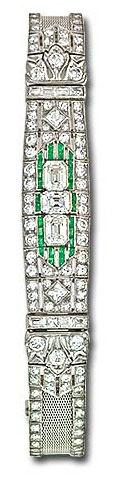Platinum Art Deco bracelet set with diamonds and emeralds.