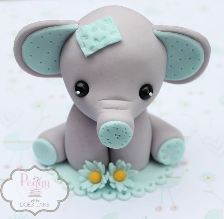 Fondant elephant cake topper.                                                                                                                                                                                 More