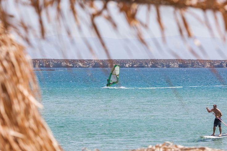 Chrissi Akti Golden Beach surfing