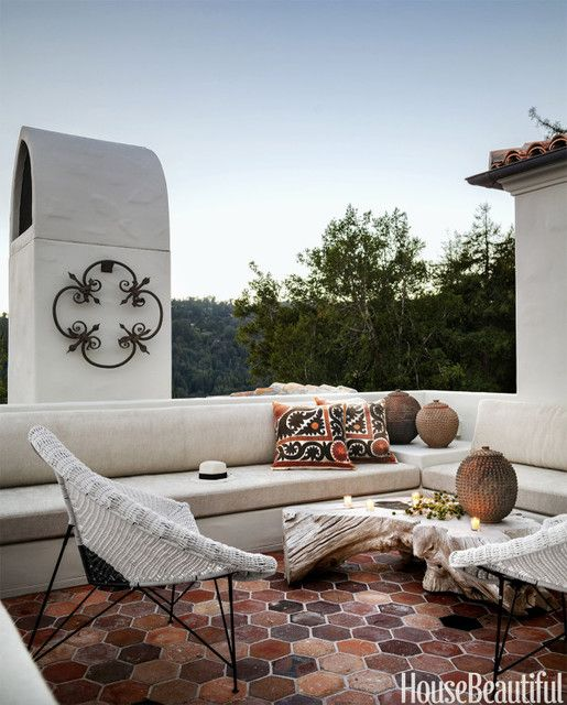 Of course there's also an upstairs terrace… with the perfect natural driftwood table and modern occasional chairs. I'm also admiring the oversized terra cotta hex tile.I'm applauding the look of this entire Spanish Colonial; I still have a difficult time believing it's a new build.
